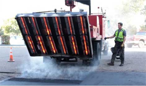 Truck with asphalt infrared heater on the back