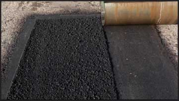 part of an asphalt patch compacted